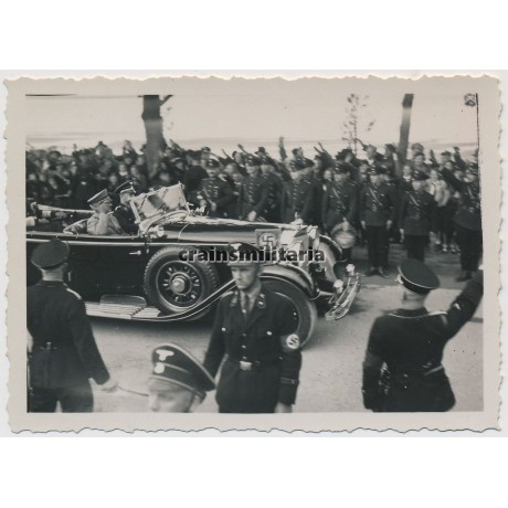 Hitler greeted by SS members while driving by