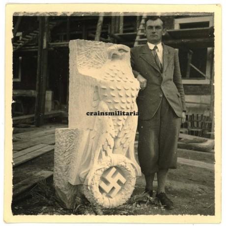 Man with sculptured Third Reich eagle