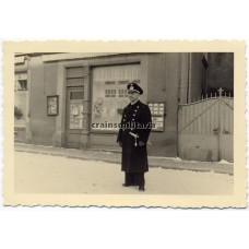 Kriegsmarine officer in front of Jewish shop