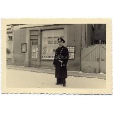 Kriegsmarine officer in front of Jewish shop