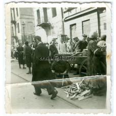 Jewish woman making firewood in Warschau Ghetto